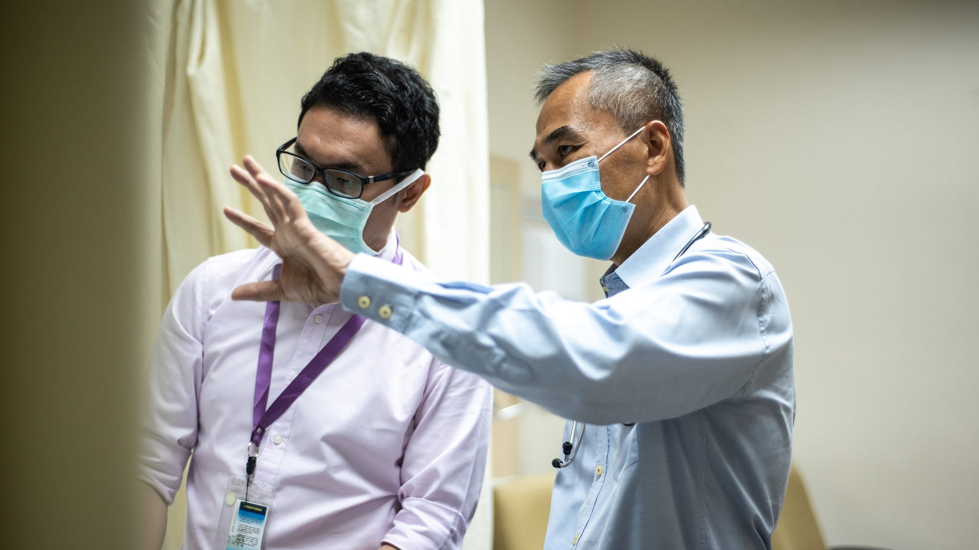 Doctors discussing in hospital setting