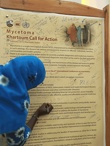 Mycetoma Call for Action being signed by a woman