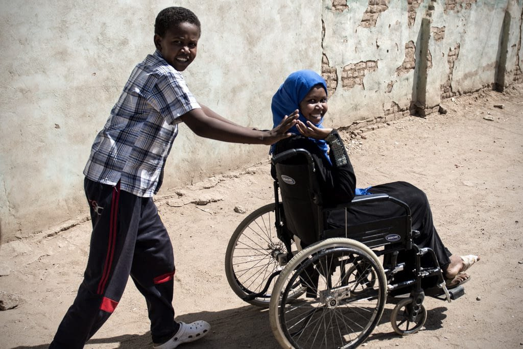 Amasi in wheelchair