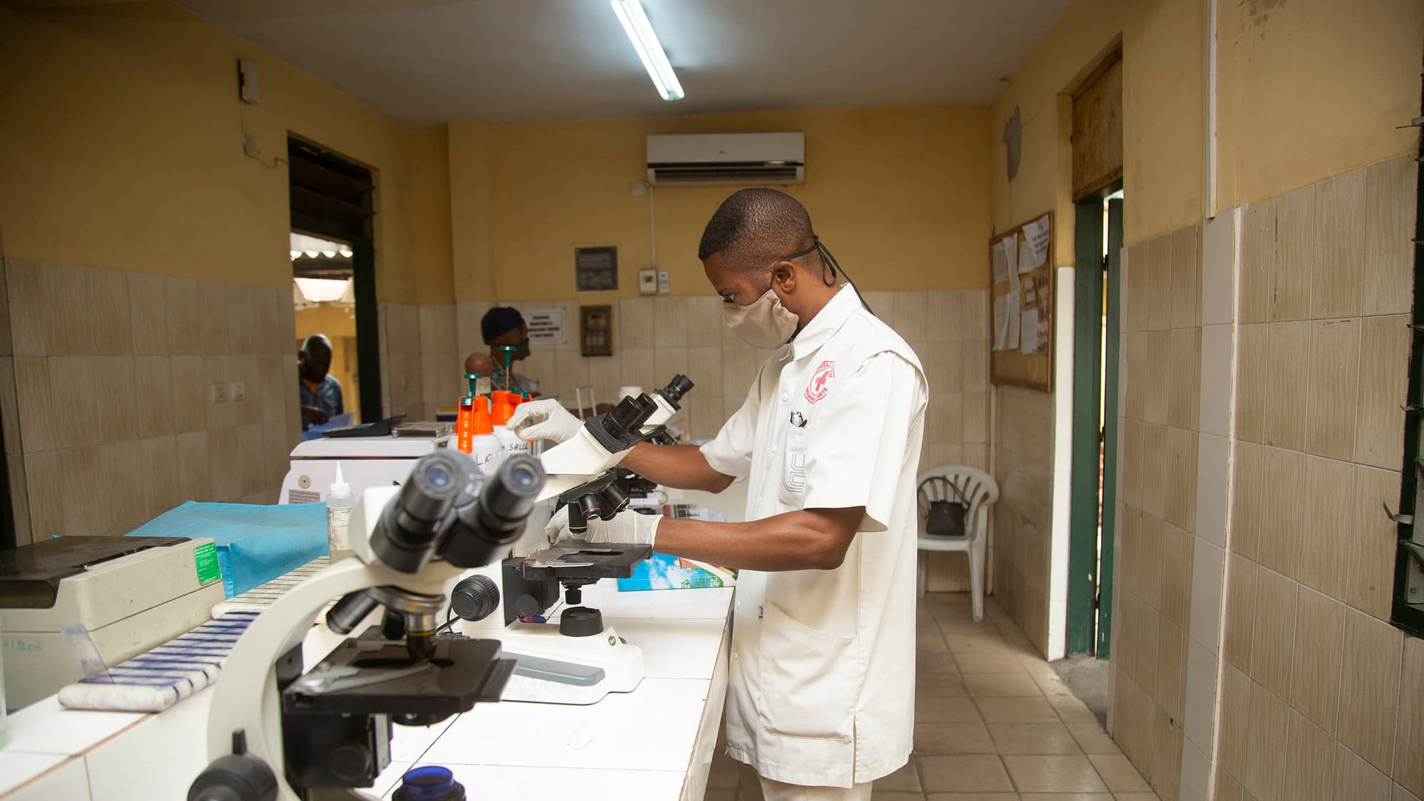 Healthcare worker with microscopes