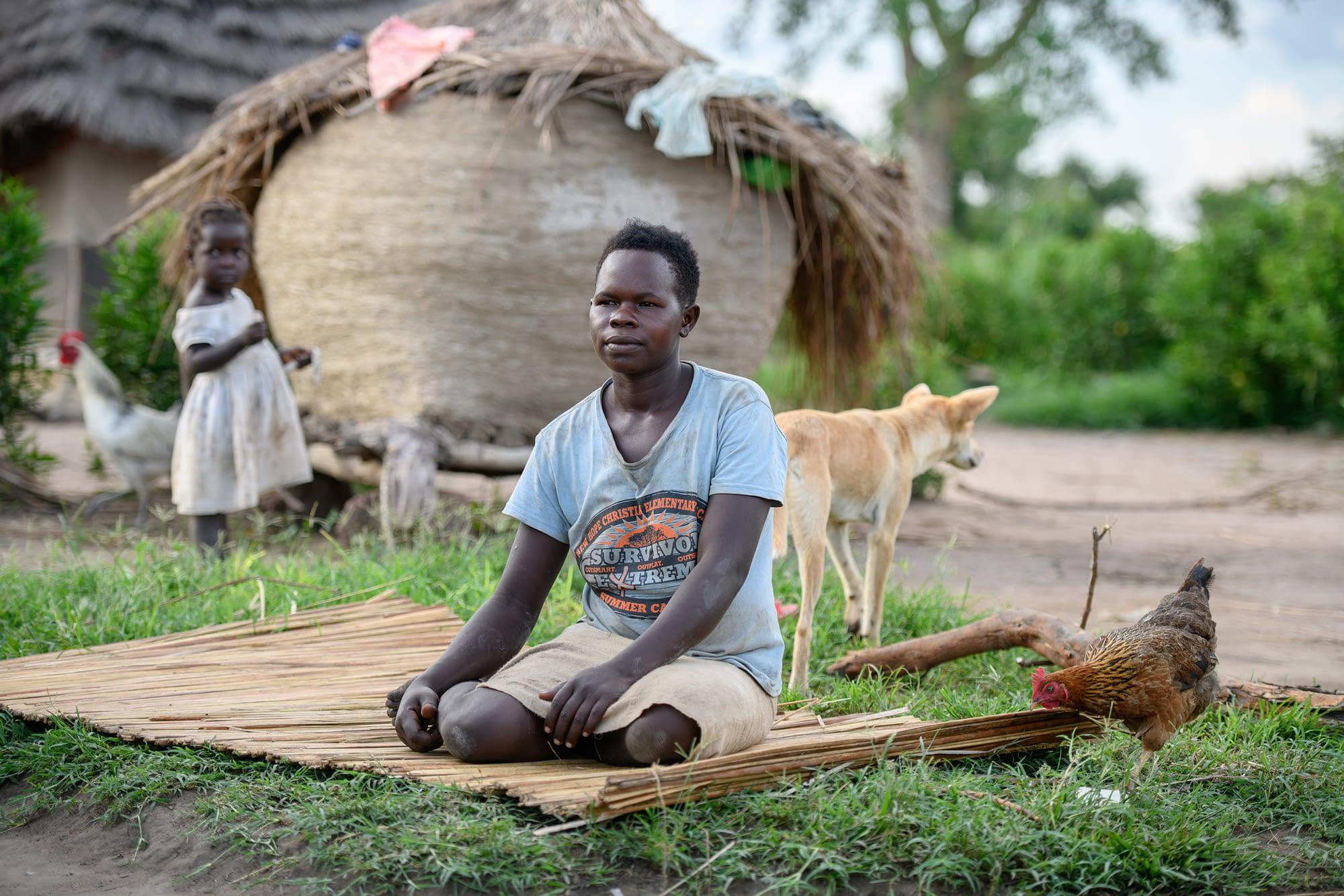 Woman sitting in rural village
