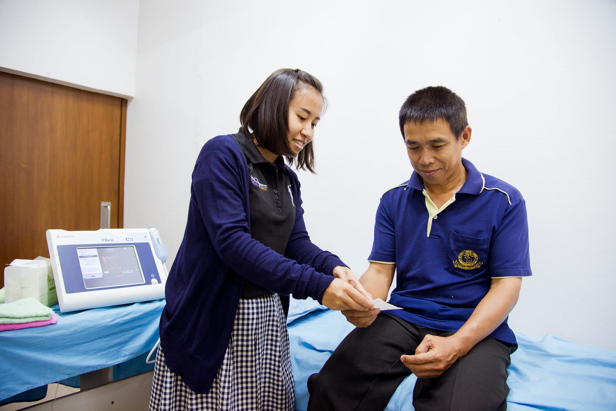 Healthcare worker with a patient in hospital setting