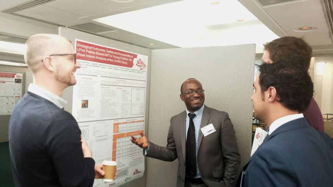 Dr Olawale Salami presenting a poster at a conference