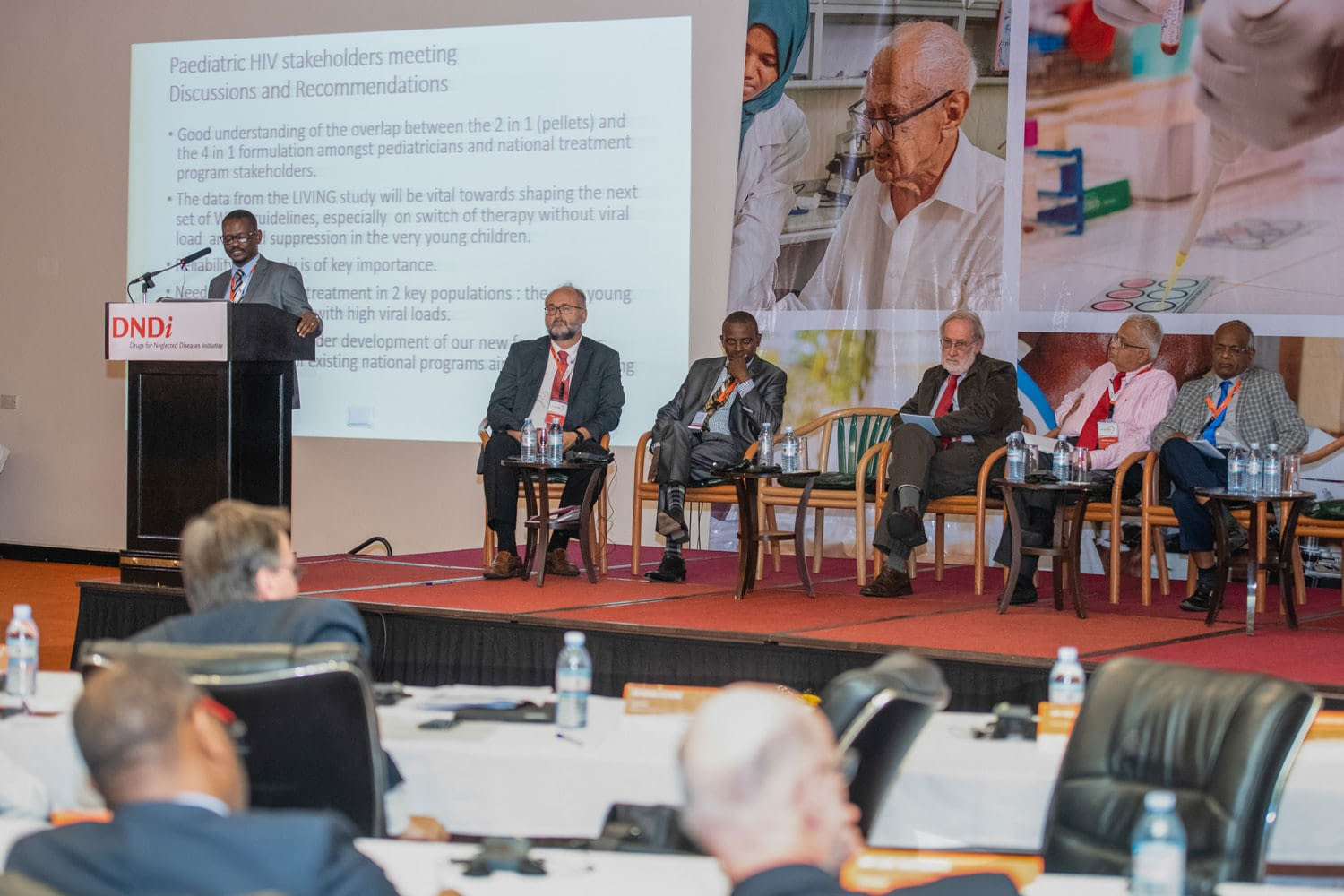 Dr Victor Mussime of Makerere University, Uganda, talks to participants about the Paediatric HIV Network, sharing the stage with, from left: Dr Graeme Bilbe, DNDi R&D Director; Dr Florent Mbo, Coordinator, HAT Platform; Dr Charles Mackenzie, Global Alliance for the Elimination of Lymphatic Filariasis; Dr Rashmi Barbhaiya, DNDi Scientific Advisory Committee; and Prof. Asrat Hailu Mekuria, Addis Ababa University, Ethiopia.