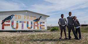 Kids standing in front of a building that says TB Free Future