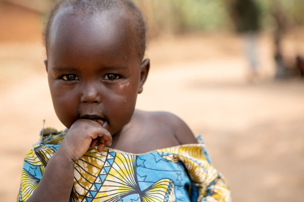 Young child looking at the camera in village in Uganda