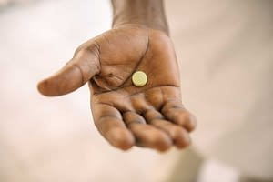 Fexinidazole pill in a hand