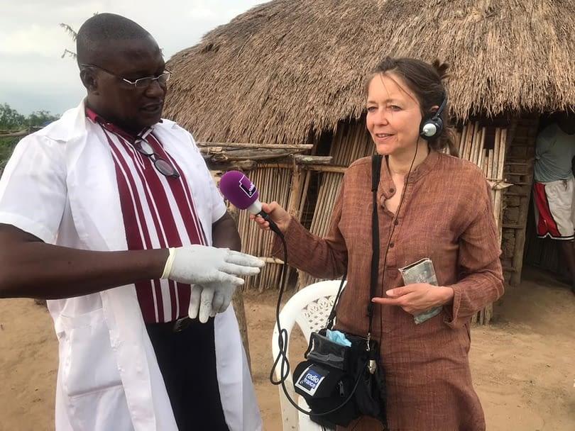 Reporter interviewing healthcare worker