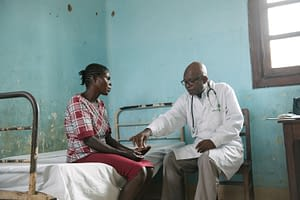 Doctor giving fexinidazole to a patient