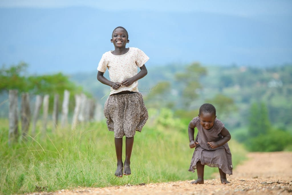 Kids jumping and smiling