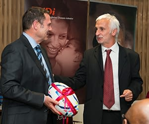 DNDi Executive Director Bernard Pécoul passes a rugby ball to David Reddy, Chief Executive Officer of MMV, to symbolise the handing over of the DNDi malaria treatments ASAQ and ASMQ to MMV