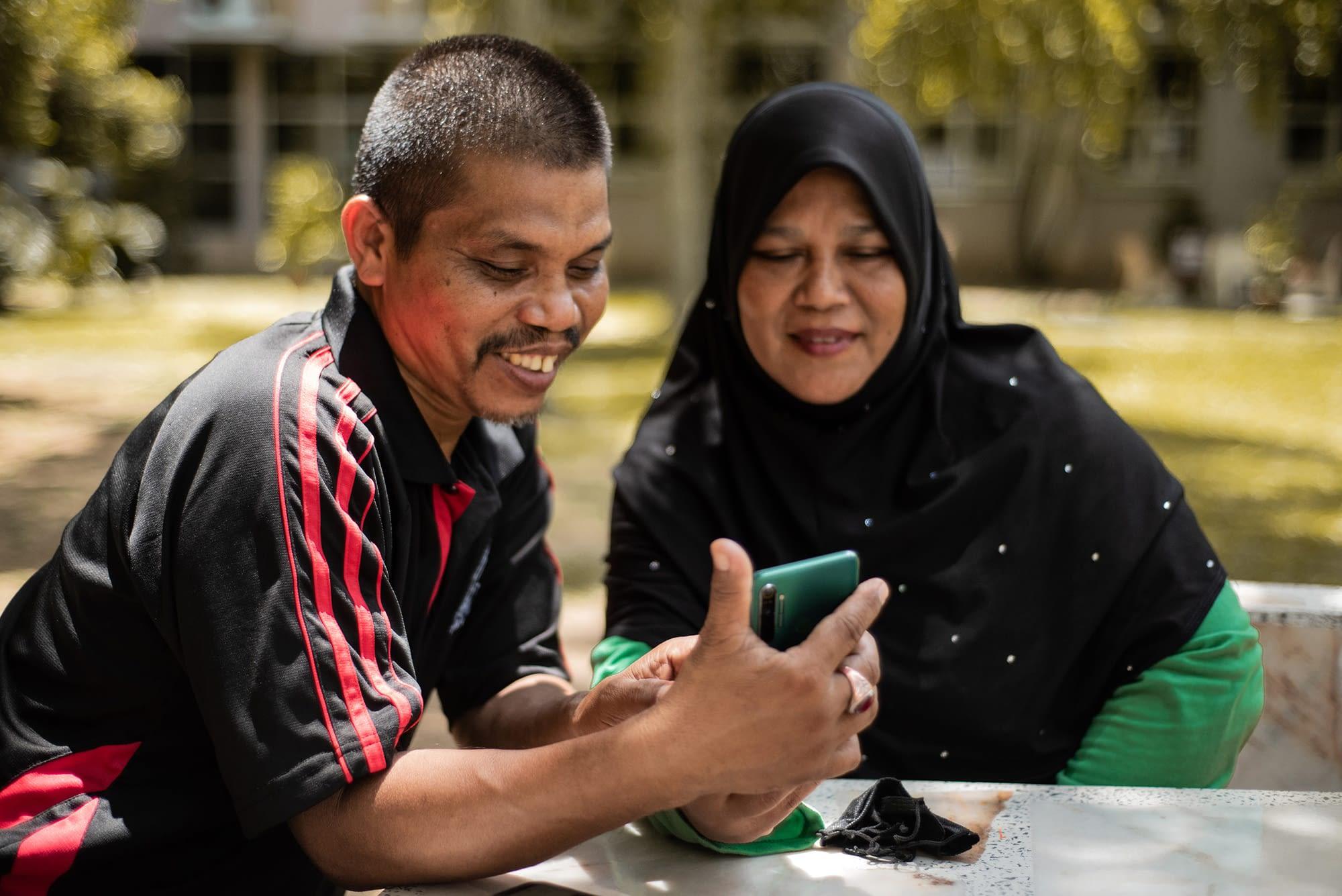 Man and woman looking at a phone