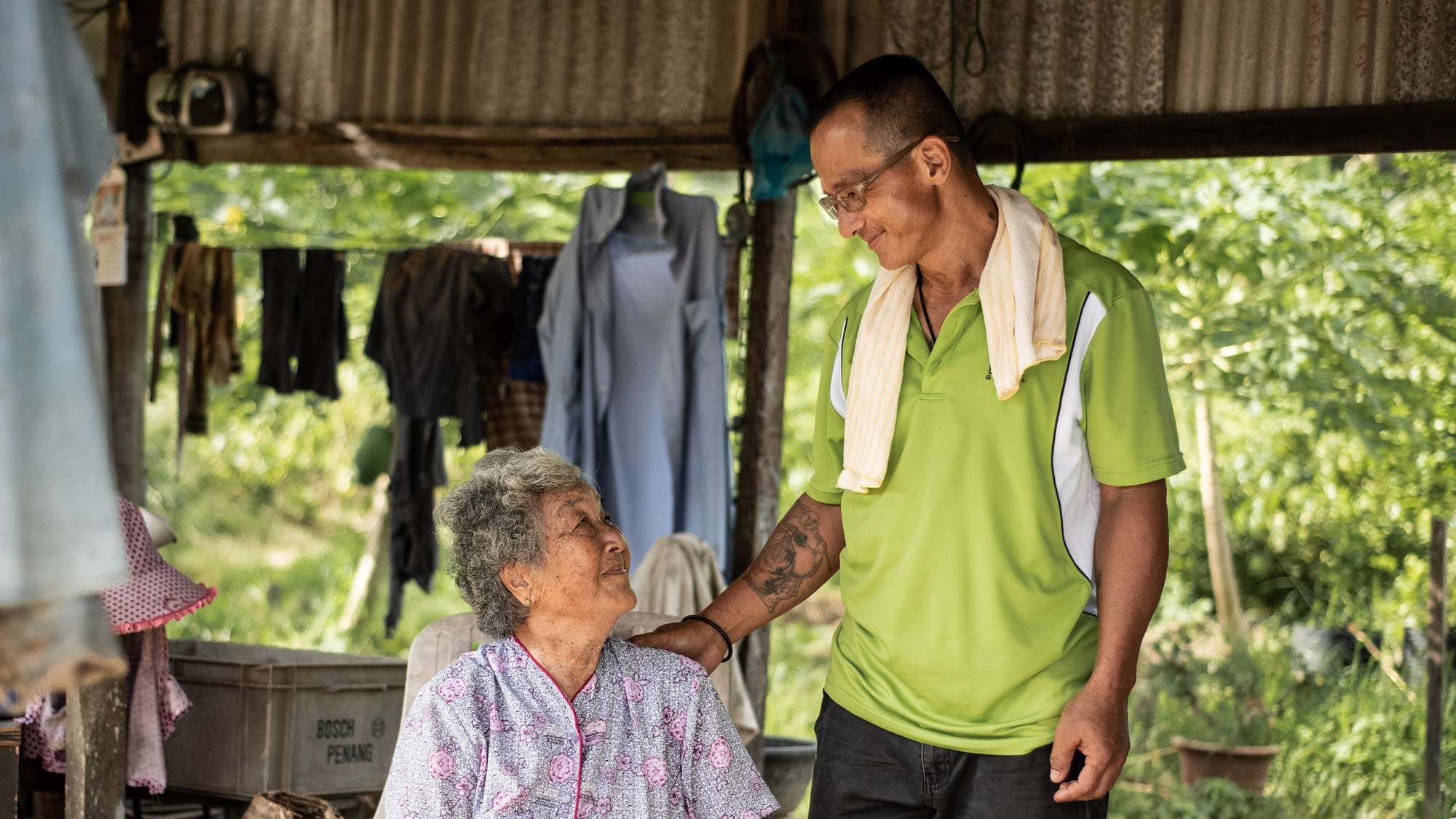 Former HCV patient looking at his mother