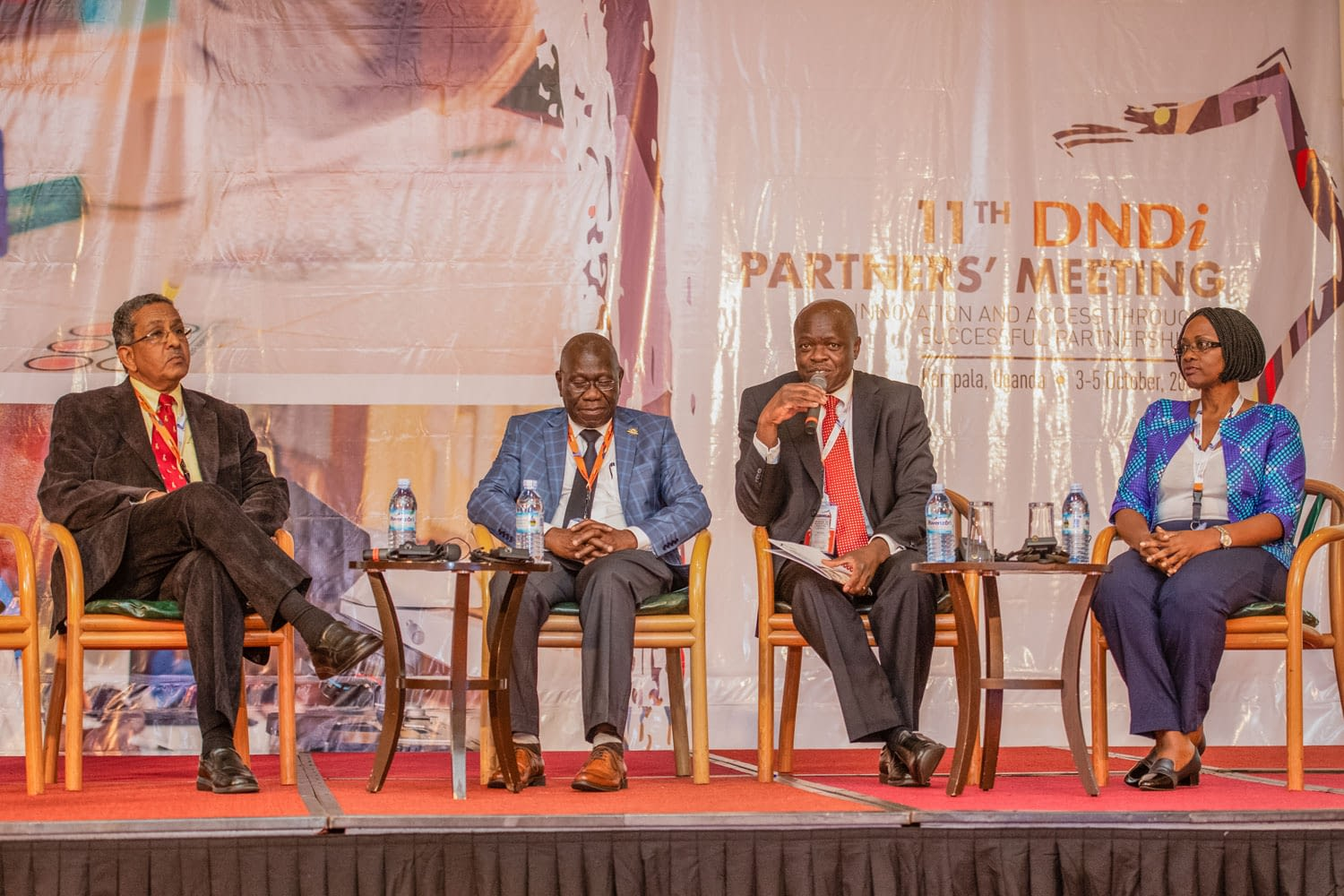 Dr Bernhards Ogutu, holding the microphone, moderates a session on enhancing medical research capacities in Eastern Africa. He is joined by Dr Juliet Mwanga of Epicenter Uganda (on the right), Prof. Celestino Obua of Mbarara University Uganda, and Prof. Ahmed Fahal of MRC Sudan (on the left)