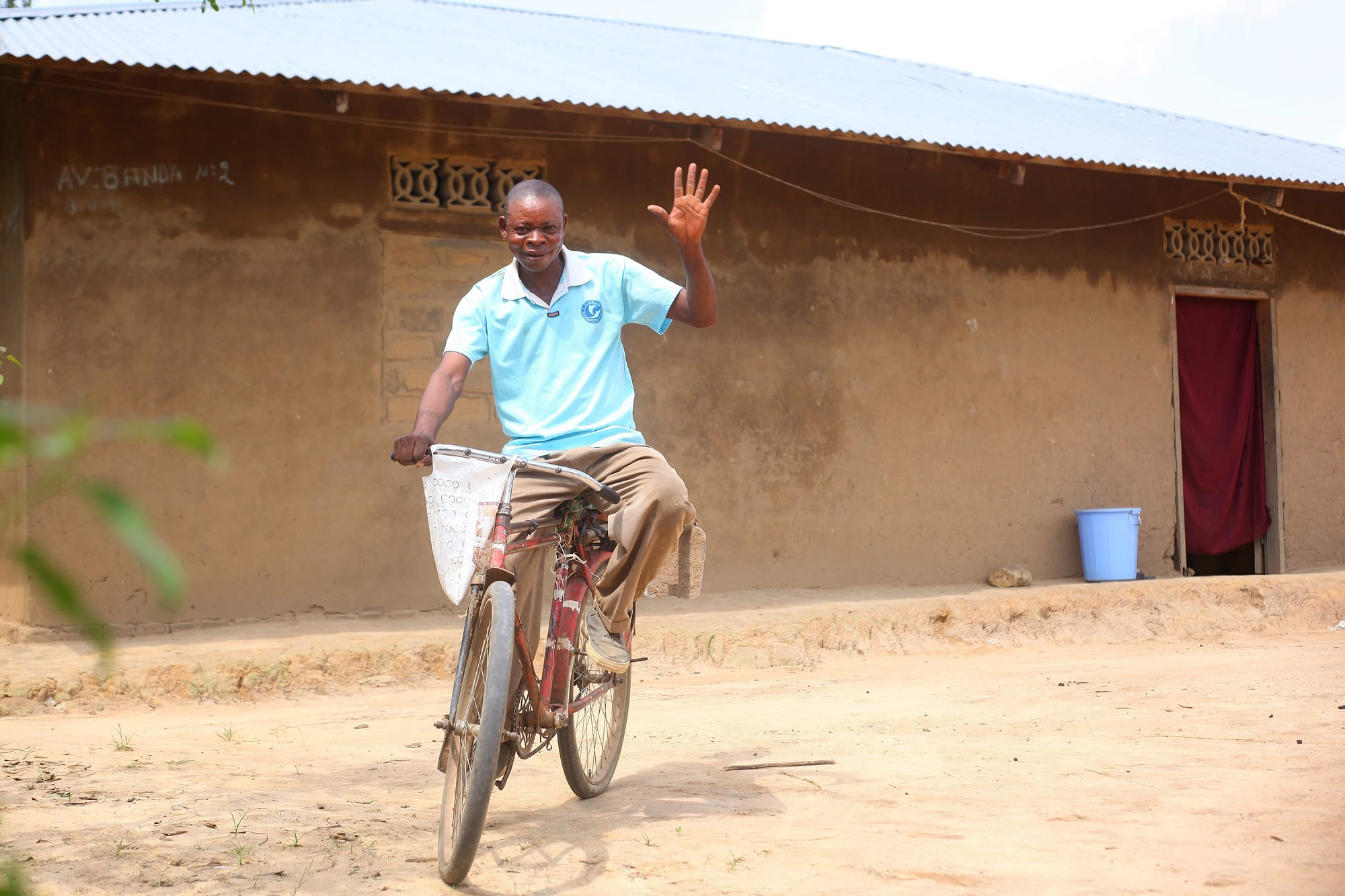 Man riding a bike in rural village