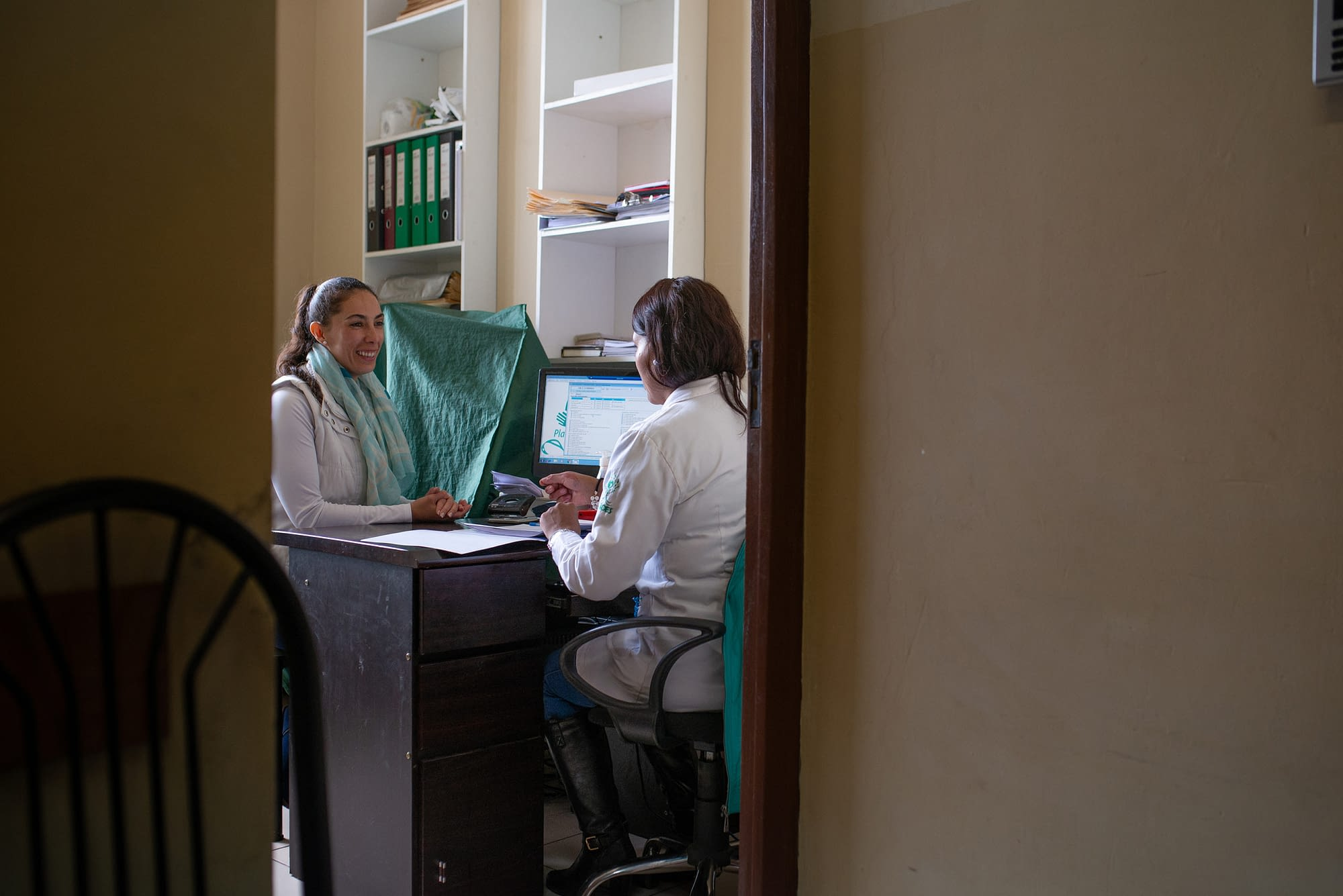 Two woman discussing in hospital setting