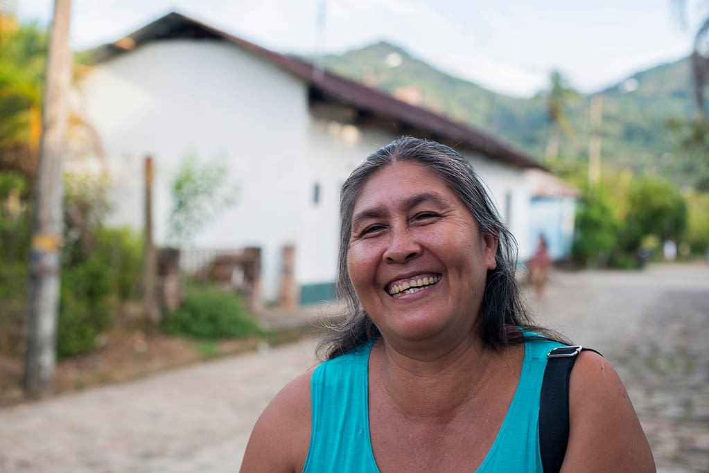 Woman with Chagas disease smiling in a street of Colombia